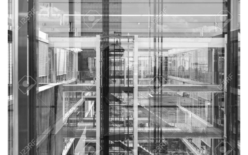 127128593-abstract-window-reflections-in-morden-office-building-contemporary-corporate-business-arch